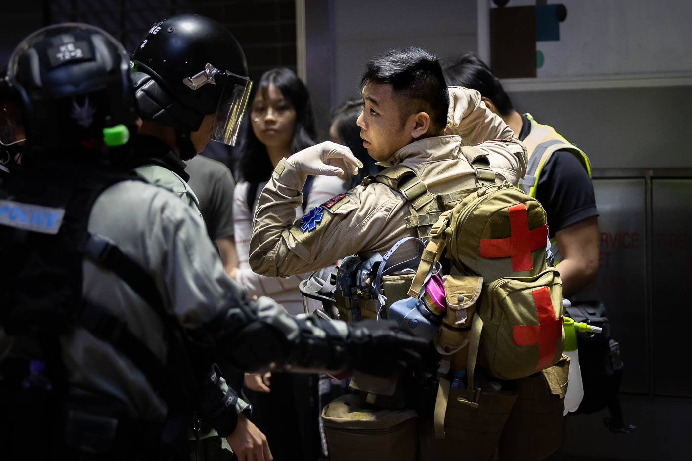 EMT is detained and searched by Hong Kong Police.