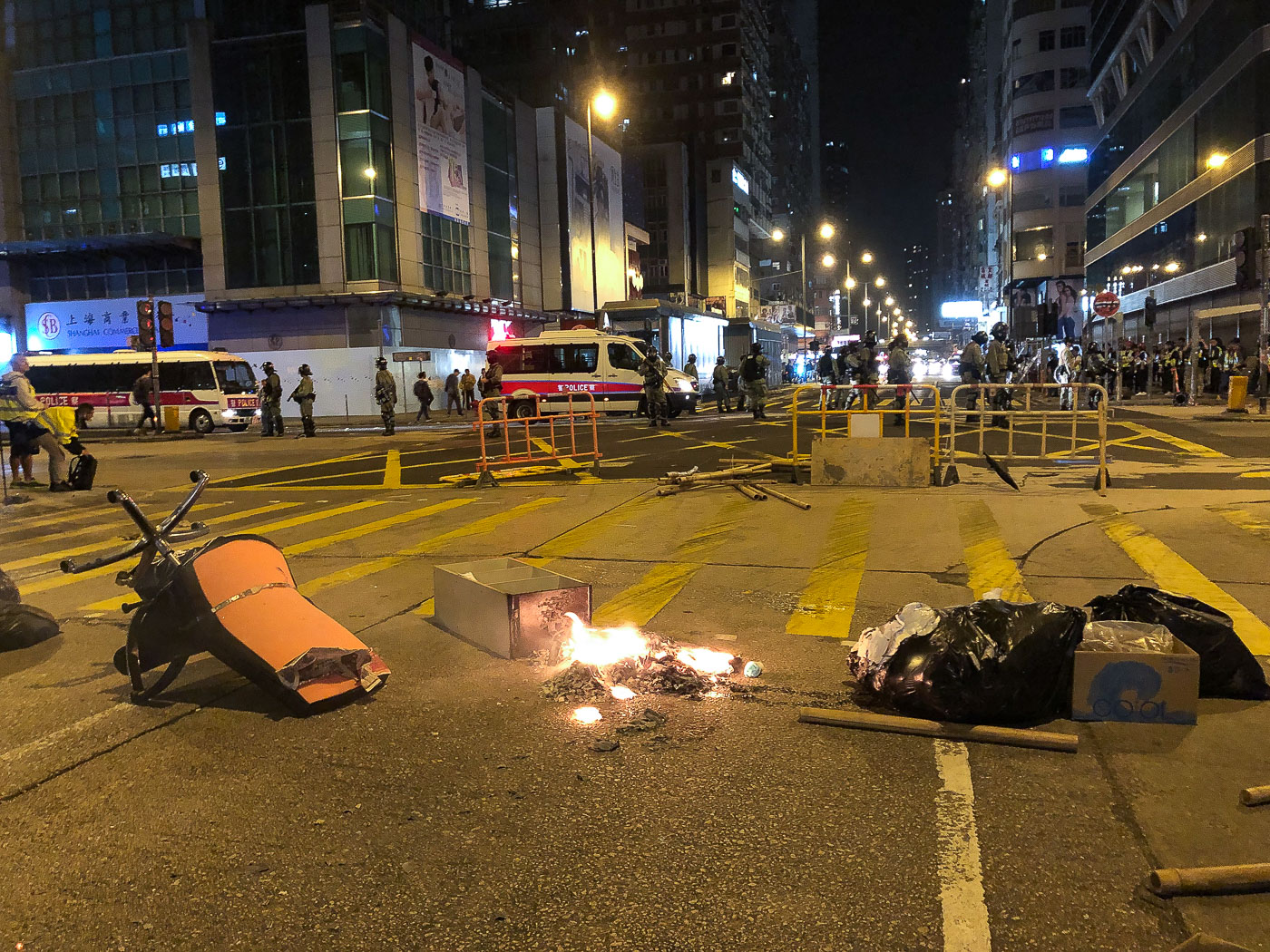 A small fire and random object set by protesters blocks street in Hong Kong.