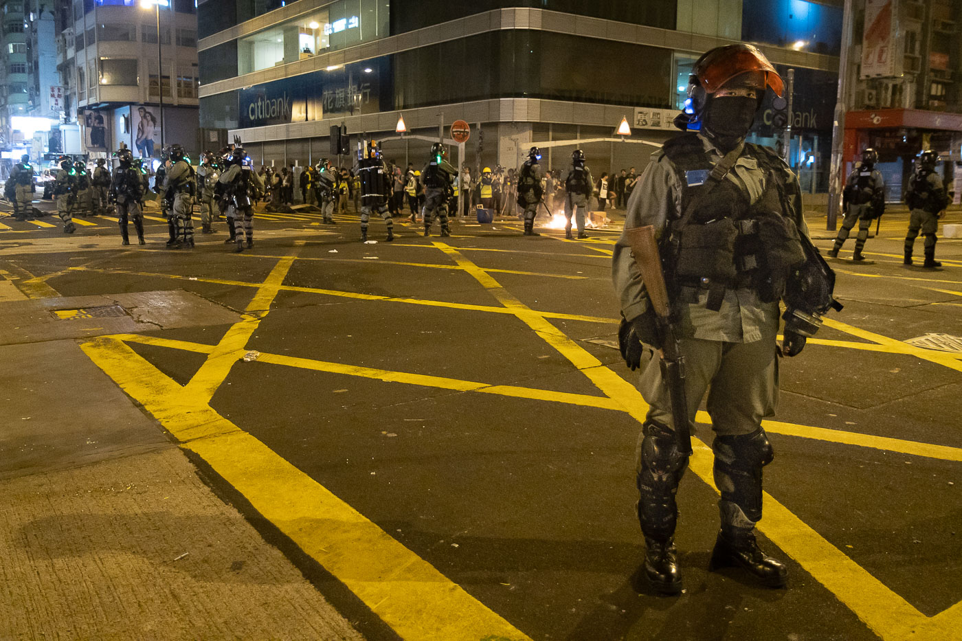 Riot cops guard intersection in Hong Kong during protests.
